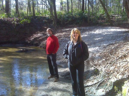 Cilla and Greg on the bank of Hogtown Creek