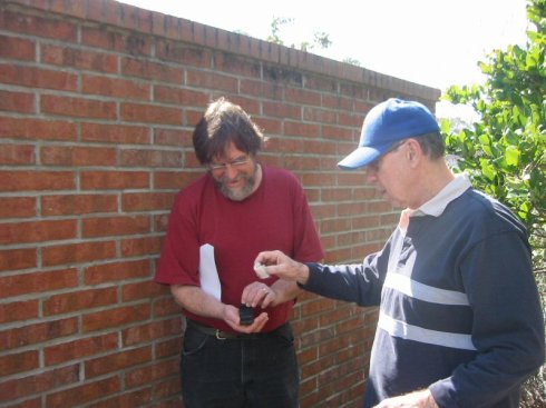 Greg is the finder of the first cache. Gordon and Greg examine the contents of this microcache.